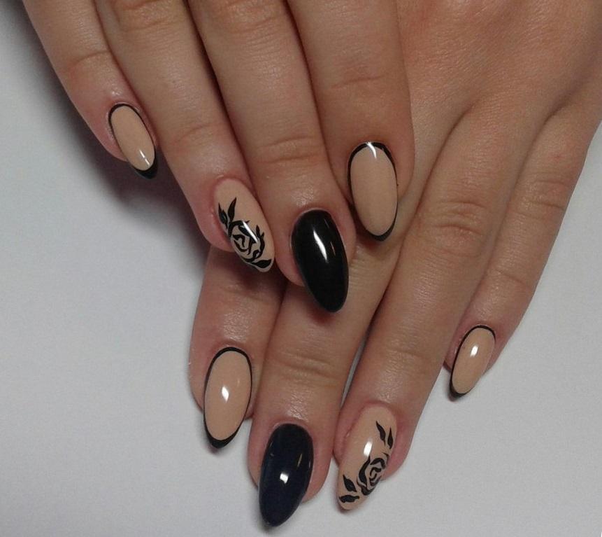 Овальные ногти с модными бежево-черными узорами
