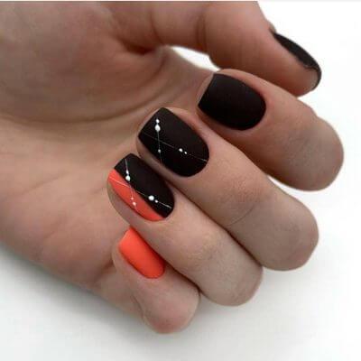 Матовый маникюр в черном и оранжевом цвете
