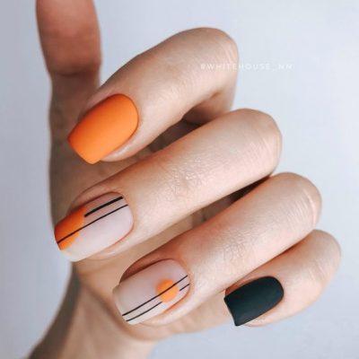 Оранжевый с черным маникюр