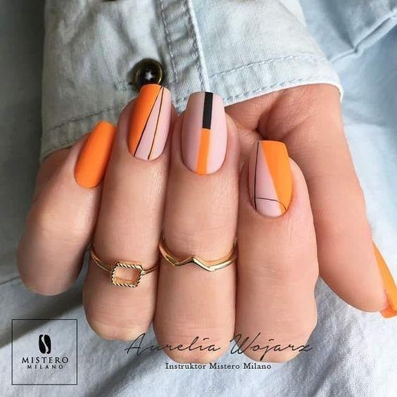 Оранжнвый маникюр с дизайном