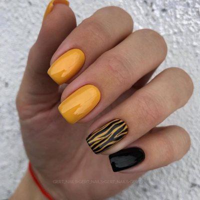 Желтый маникюр с черным зебра