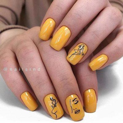 Желтый маникюр с лицами